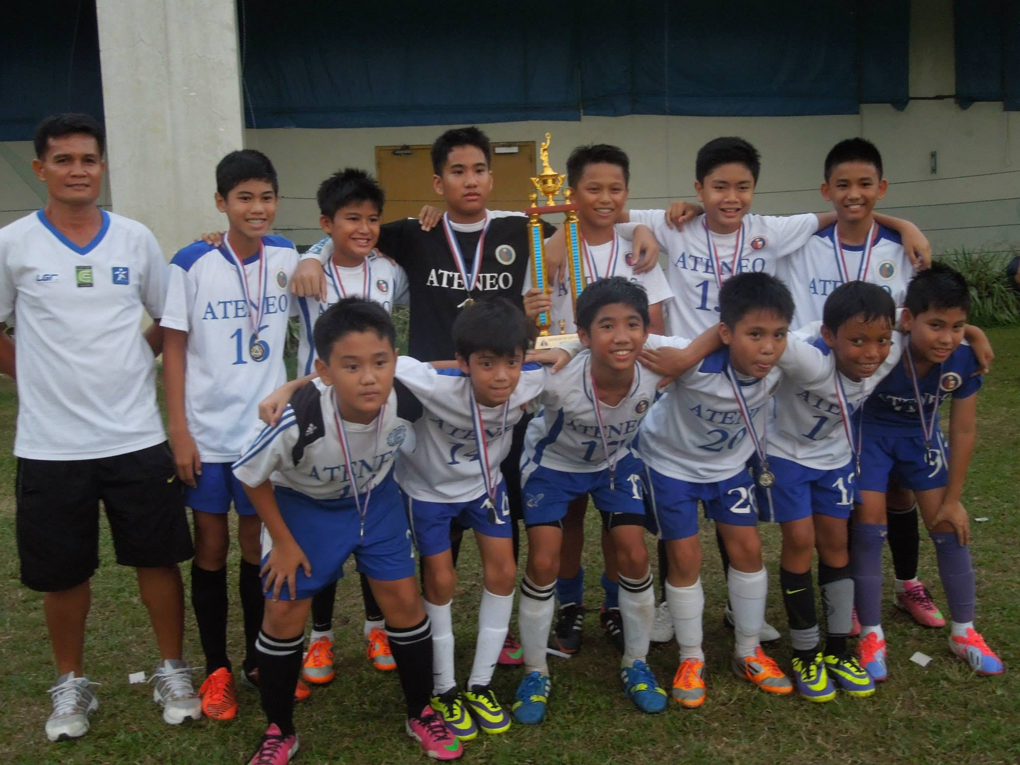 Ateneo football team with Miggy medal